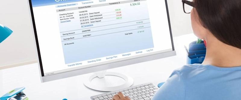 Close-up Of A Businesswoman Doing Online Banking In Office