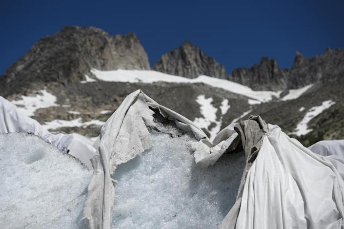 The blankets reduce the ice melt by as much as 70 percent (AFP Photo/Fabrice Coffrini)