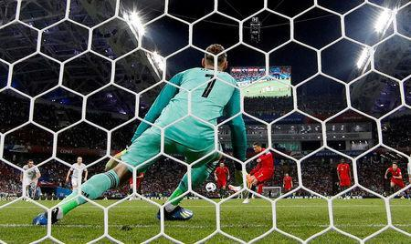 FILE PHOTO: Fisht Stadium, Sochi, Russia - June 15, 2018 Portugal's Cristiano Ronaldo scores their first goal from the penalty spot past Spain's David De Gea REUTERS/Murad Sezer/File Photo