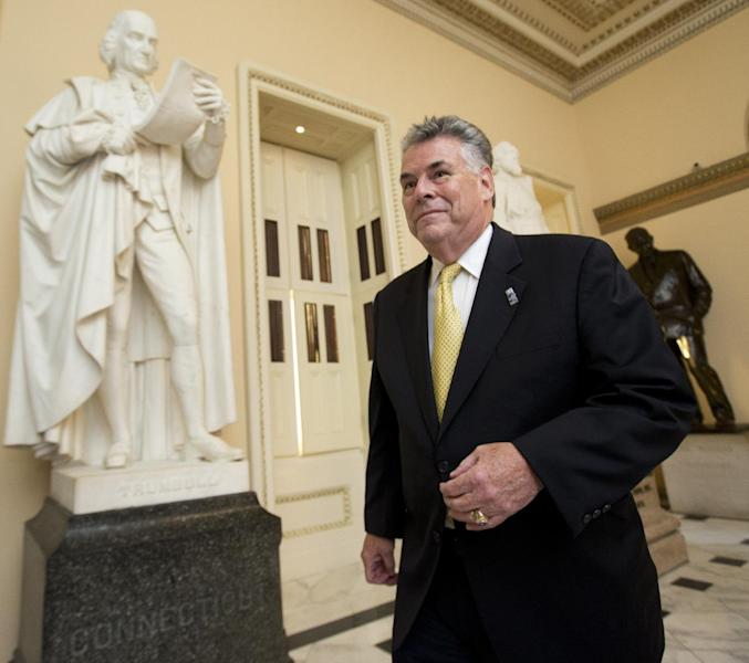 "In this Spet. 30, 2013, photo, Rep. Peter King, R-N.Y., walks towards the House Chamber on Capitol Hill, in Washington. The Republican Party's two Kings in Congress both voted against GOP leaders' latest effort to prevent President Barack Obama's health care overhaul from becoming entrenched, but for opposite reasons. Peter King says it was a mistake to link curbing ""Obamacare"" with averting a government shutdown. Iowa congressman Steve King characterizes Boehner's measure to delay making millions of people buy health insurance for year as a retreat from defunding the new health care law entirely. (AP Photo/Manuel Balce Ceneta)"
