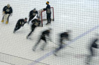 Boston Bruins players skate around a goal during a speed drill at the team's NHL hockey training camp, Monday, Jan. 4, 2021, in Boston. (AP Photo/Elise Amendola)