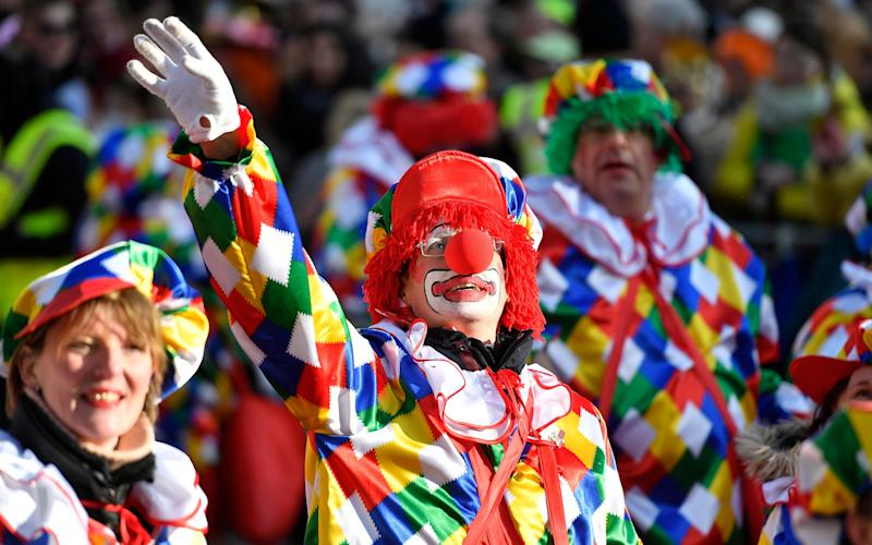 A carnevalist dressed as clown waves during the traditional Rose Monday parade in Duesseldorf, Germany, - Copyright 2018 The Associated Press. All rights reserved.