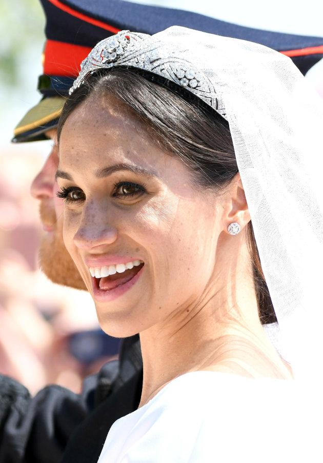 Meghan, Duchess of Sussex leaves Windsor Castle in the Ascot Landau carriage during a procession after getting married at St Georges Chapel on May 19, 2018 in Windsor, England.