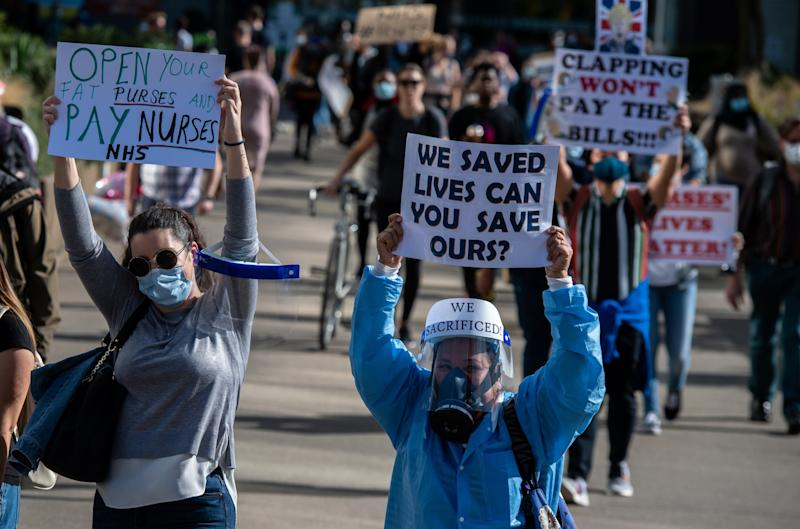 NHS workers wear masks as they protest in central London (Getty Images)