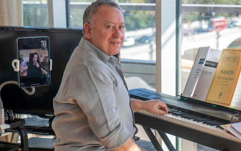 Brian Cohen having piano lesson from Genia via Zoom. He's an orthopaedic surgeon at the Kings Edward VII private hospital by day - Paul Grover/Paul Grover