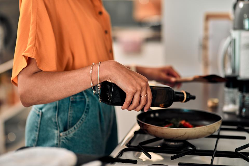 Cropped shot of a young woman preparing a healthy meal at home