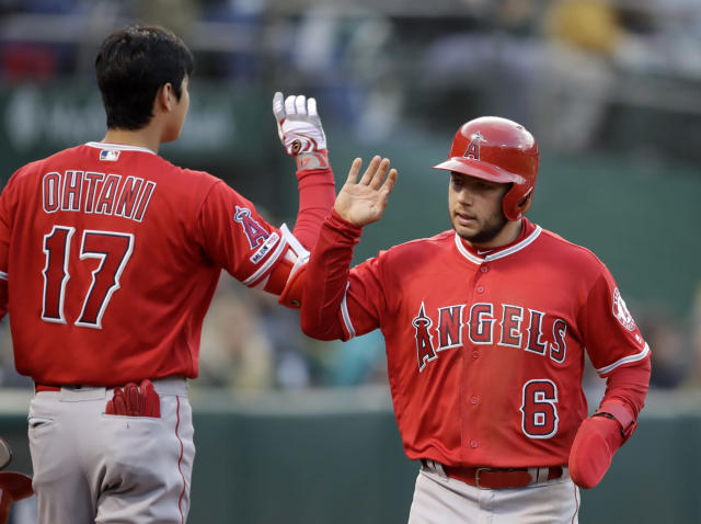 Los Angeles Angels' David Fletcher, right, is congratulated by Shohei Ohtani (17) after scoring against the Oakland Athletics in the second inning of a baseball game, Tuesday, May 28, 2019, in Oakland, Calif. (AP Photo/Ben Margot)