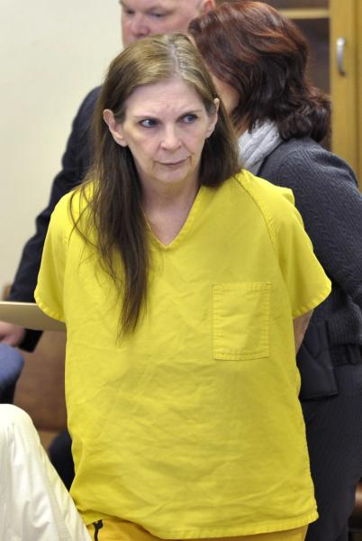 Defendant Donna Scrivo looks towards the courtroom. at her arraignment at 40th District Court in St. Clair Shores, Mich., on Feb. 3, 2014. Scrivo is charged with mutilating and illegally removing a corpse after her 32-year-old son's body parts were found in bags along two rural roadways. (AP Photo/Detroit News, Robin Buckson) DETROIT FREE PRESS OUT; HUFFINGTON POST OUT
