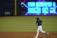 Miami Marlins' Adam Duvall rounds second base after hitting a home run during the fourth inning of a baseball game against the Atlanta Braves, Saturday, June 12, 2021, in Miami. (AP Photo/Wilfredo Lee)