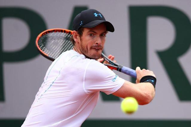 "<a class=""link rapid-noclick-resp"" href=""/olympics/rio-2016/a/1211276/"" data-ylk=""slk:Andy Murray"">Andy Murray</a> goes for a backhand shot during his fourth round French Open match with Karen Khachanov. Murray prevailed in three sets and notched his 650th win. (Getty Images)"