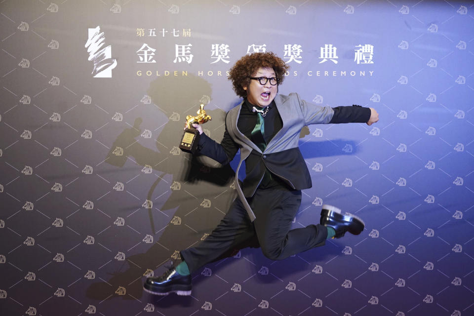 "Taiwanese actor Nadow Lin holds his award for Best Supporting Actor at the 57th Golden Horse Awards in Taipei, Taiwan, Saturday, Nov. 21, 2020. Lin won for the film ""Classmates Minus"" at this year's Golden Horse Awards. (AP Photo/Billy Dai)"