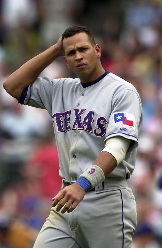 CHICAGO - JUNE 19: Shortstop Alex Rodriguez #3 of the Texas Rangers walks on the field against the Chicago Cubs during the MLB game at Wrigley Field in Chicago, Illinois on June 19, 2002. The Rangers defeated the Cubs 7-4. (Photo by Jonathan Daniel/Getty Images)
