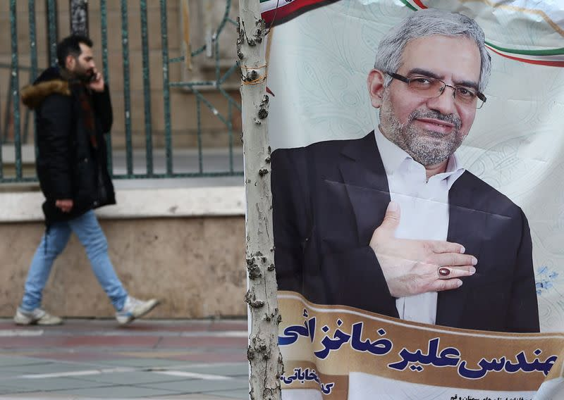 A banner of a parliamentary candidate is seen in Tehran