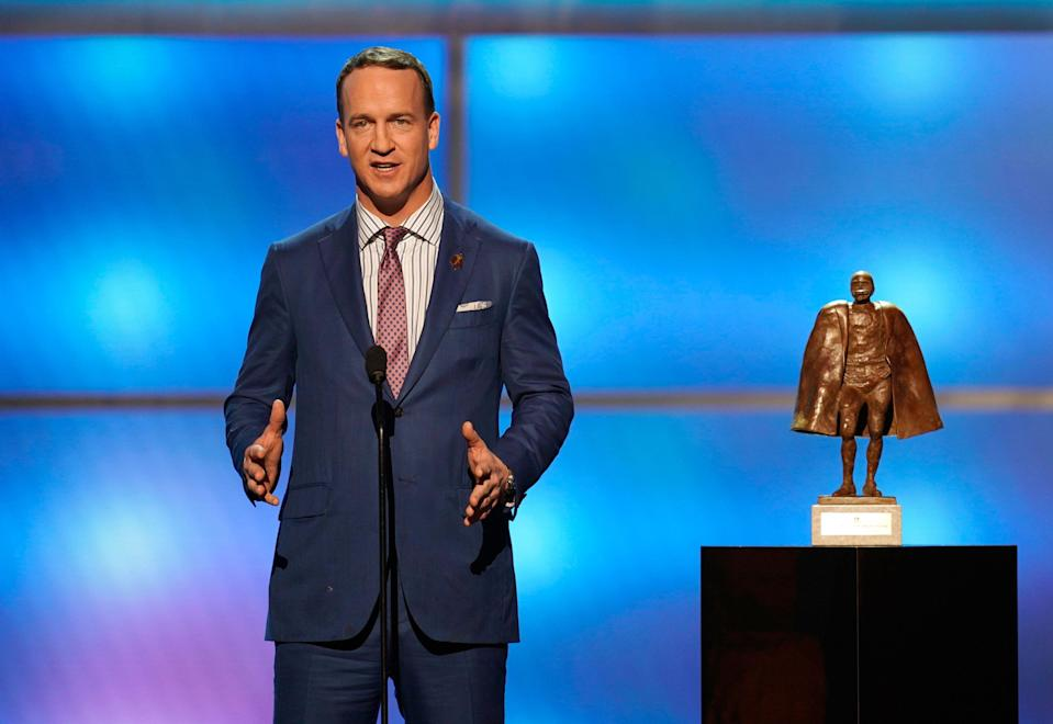 """Peyton Manning, shown presenting the Walter Payton NFL Man of the Year award in February, won't be joining """"Monday Night Football,"""" according to a report. (AP)"""