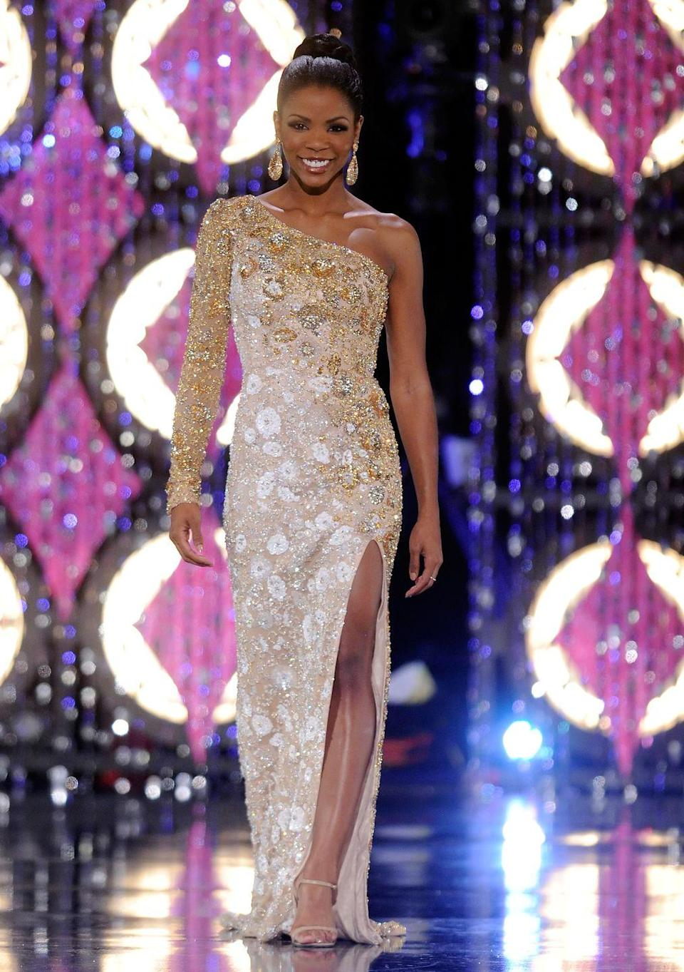<p>Djuan Keila Trent of Kentucky opted for a one-shoulder sequined gown and statement earrings—a big accessory trend of the early 2010s.</p>