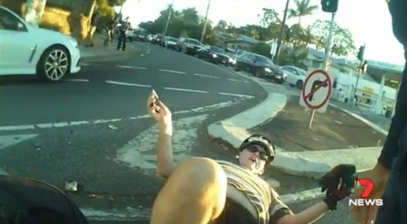 The driver offers up excuses while the cyclist languishes on the ground. Source: 7 News