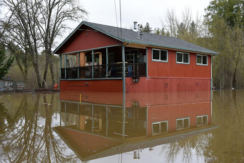 Flood waters from the Russian River surround a home in Forestville, Calif., on Feb. 27, 2019. (Photo: Michael Short/AP)