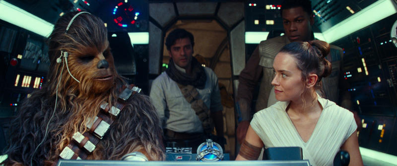 "This image released by Disney/Lucasfilm shows, from left,  Joonas Suotamo as Chewbacca, Oscar Isaac as Poe Dameron, Daisy Ridley as Rey and John Boyega as Finn in a scene from ""Star Wars: The Rise of Skywalker."" (Disney/Lucasfilm Ltd. via AP)"
