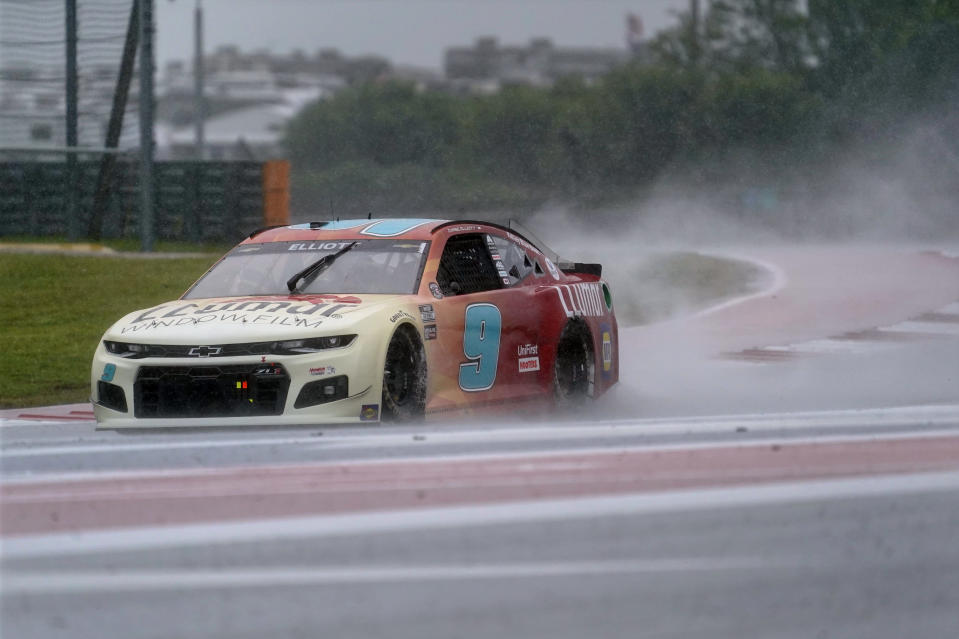 Chase Elliott (9) drives out of Turn 18 during practice for Sunday's NASCAR Cup Series auto race at the Circuit of the Americas in Austin, Texas, Saturday, May 22, 2021. (AP Photo/Chuck Burton)