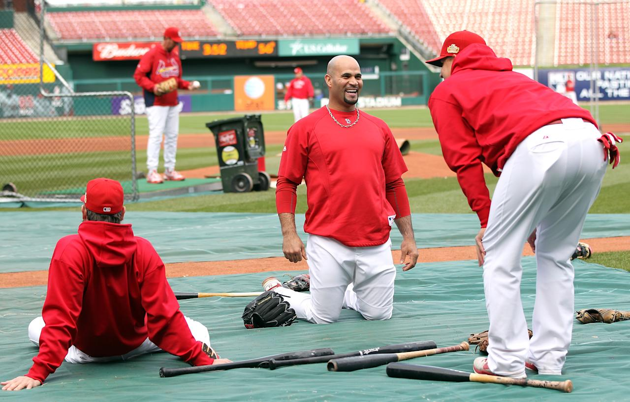 ST LOUIS, MO - OCTOBER 20:  Albert Pujols #5 of the St. Louis Cardinals stretches on the field during batting practice prior to Game Two of the MLB World Series against the Texas Rangers at Busch Stadium on October 20, 2011 in St Louis, Missouri.  (Photo by Jamie Squire/Getty Images)