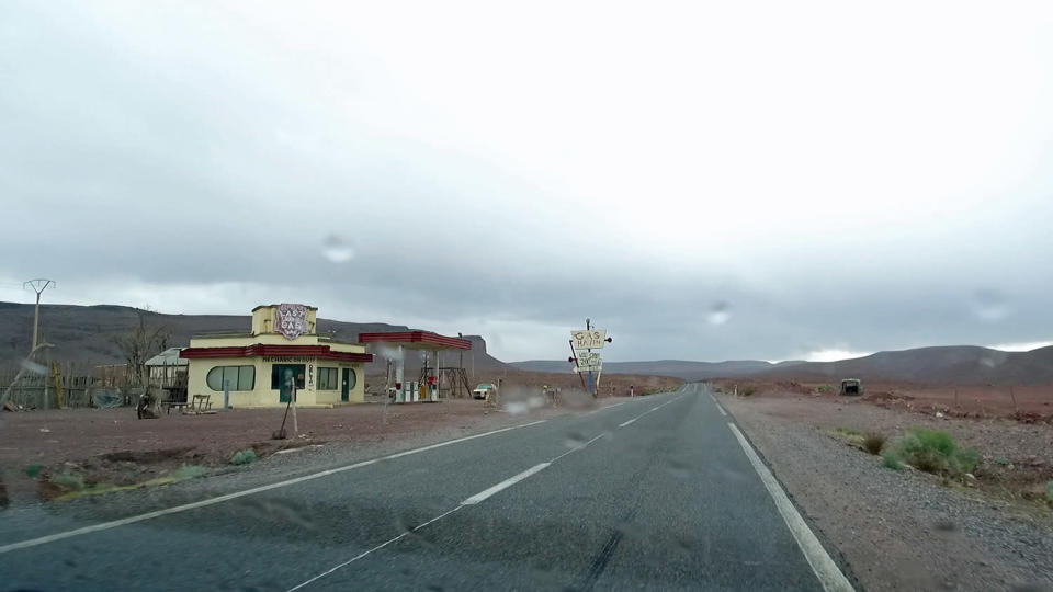 <p>A pivotal set from the remake of <em>The Hills Have Eyes</em> has remained abandoned on a highway in Morocco well over a decade after the horror film was shot. The relatively unchanged location confuses many drivers, who assume it's a working gas station. Inside, dust-covered American goods litter the eerie store shelves. (Photo: Bob Thissen/Caters News) </p>