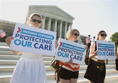 Supporters of the Affordable Healthcare Act gather in front of the Supreme Court before the court's announcement of the legality of the law