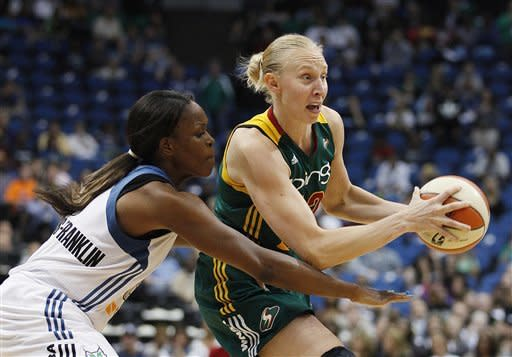 Seattle Storm center Ann Wauters (12) protects the ball from Minnesota Lynx forward Taj McWilliams-Franklin during in the second half of Game 1 of the WNBA basketball first-round playoff series Friday, Sept. 28, 2012, in Minneapolis. The Lynx won 78-70. (AP Photo/Stacy Bengs)