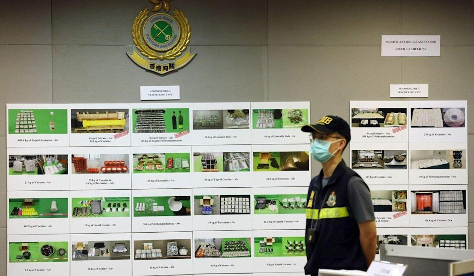 A customs officer during the press conference displaying the items confiscated during the operation. Photo: Nora Tam