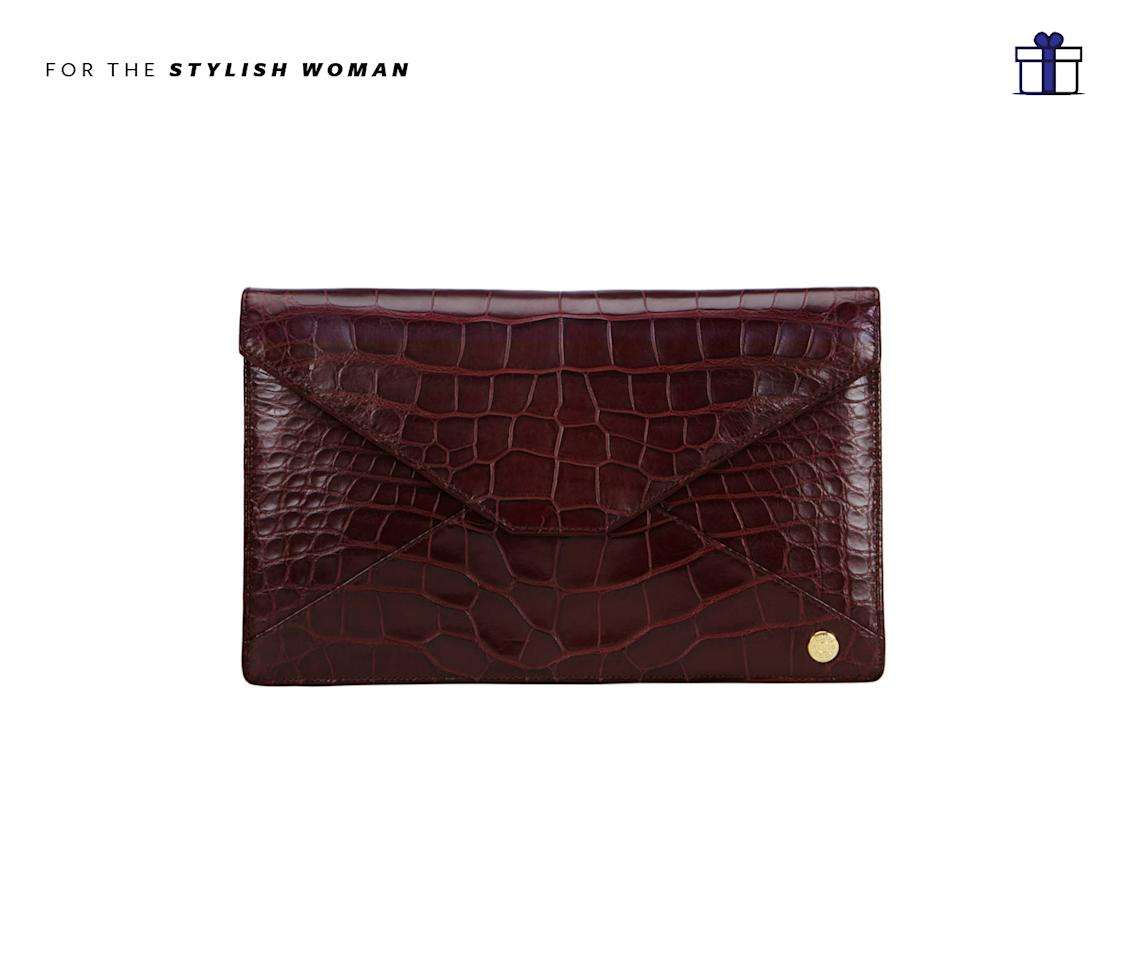 """<p>Compact, yet luxurious — a clutch made to dash and go. Adysen Envelope Clutch in Burgundy Alligator, $5,800, <a rel=""""nofollow"""" href=""""https://www.stalvey.com/product/adysen-envelope-clutch-burgundy-alligator/"""">stalvey.com</a> </p>"""
