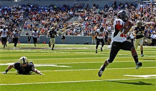 Northern Illinois' Tommylee Lewis runs for a touchdown past Army's Justin Trimble during the first half in an NCAA college football game in West Point, N.Y., on Saturday, Sept. 15, 2012. (AP Photo/Craig Ruttle)