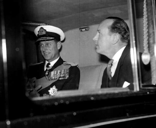 Philip with his former private secretary Lieutenant-Commander Mike Parker, who insisted the duke was 100% faithful to the Queen