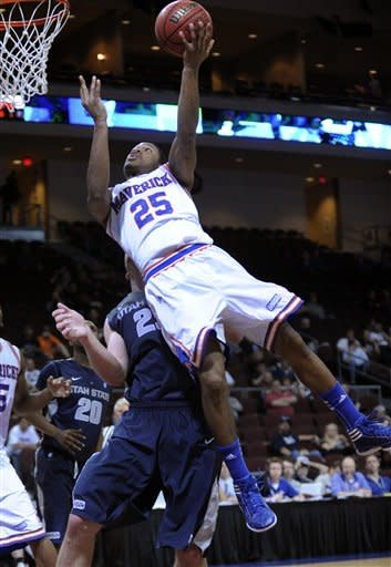 UT Arlington's Cameron Catlett (25) shoot against Utah State during the second half of a Western Athletic Conference tournament NCAA college basketball game, Thursday, March 14, 2013 in Las Vegas. UT Arlington won 83-78. (AP Photo/David Becker)
