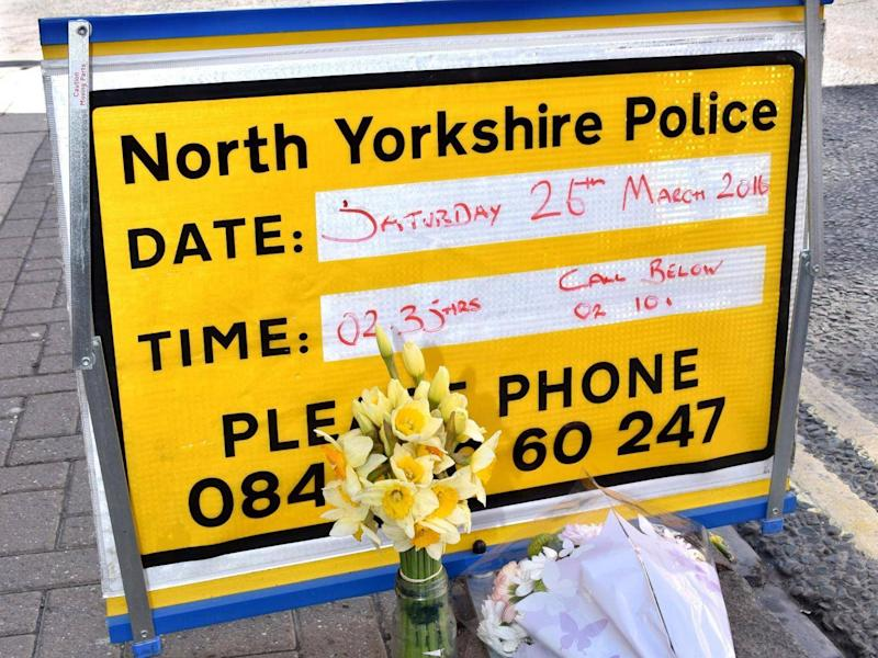 Floral tributes at the scene (York Press / SWNS.com)