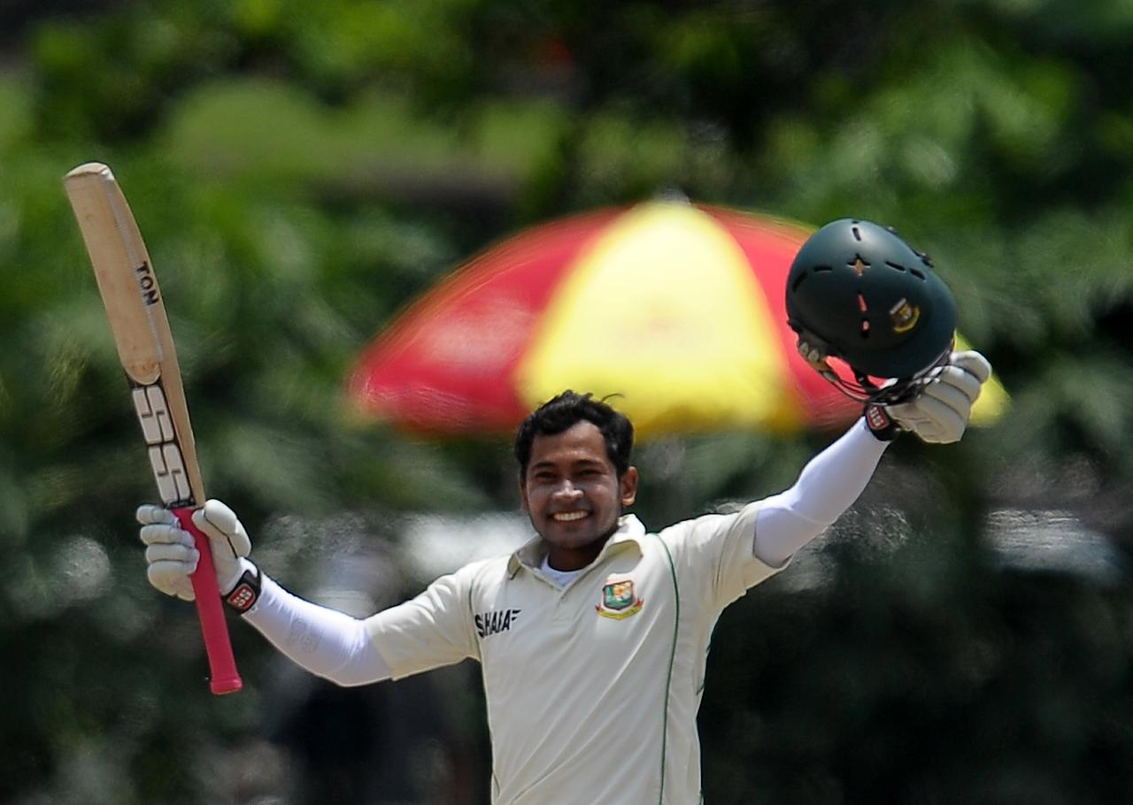 Bangladeshi captain Mushfiqur Rahim raises his bat and helmet in celebration after scoring a double century (200 runs) during the fourth day of the opening Test match between Sri Lanka and Bangladesh at the Galle International Cricket Stadium in Galle on March 11, 2013. AFP PHOTO/ LAKRUWAN WANNIARACHCHI        (Photo credit should read LAKRUWAN WANNIARACHCHI/AFP/Getty Images)