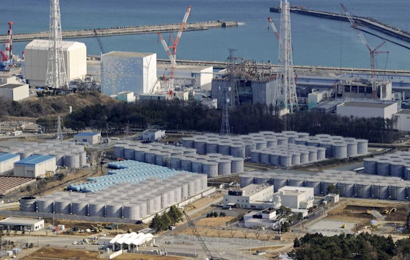 FILE - In this Feb. 10, 2013 file photo, tens of cylindrical tanks built for storage of polluted water are seen near the four reactor buildings, background, at the tsunami-devastated Fukushima Dai-Ichi nuclear plant in Okuma, northern Japan, where preparations for dismantlement of the facilities are underway. Nuclear Regulation Authority Chairman Shunichi Tanaka said Wednesday, April 10, 2013 that leaks of radioactive water from underground tanks are undermining efforts to decommission the plant. The plant's operator Tokyo Electric Power Co. said three of the seven underground tanks are leaking, but that the contaminated water is not believed to have reached the ocean. However, experts suspect that water has leaked steadily into the sea since early in the crisis, citing high radiation levels in fish in waters off the plant. (AP Photo/Kyodo News, File) JAPAN OUT, MANDATORY CREDIT, NO LICENSING IN CHINA, HONG KONG, JAPAN, SOUTH KOREA AND FRANCE