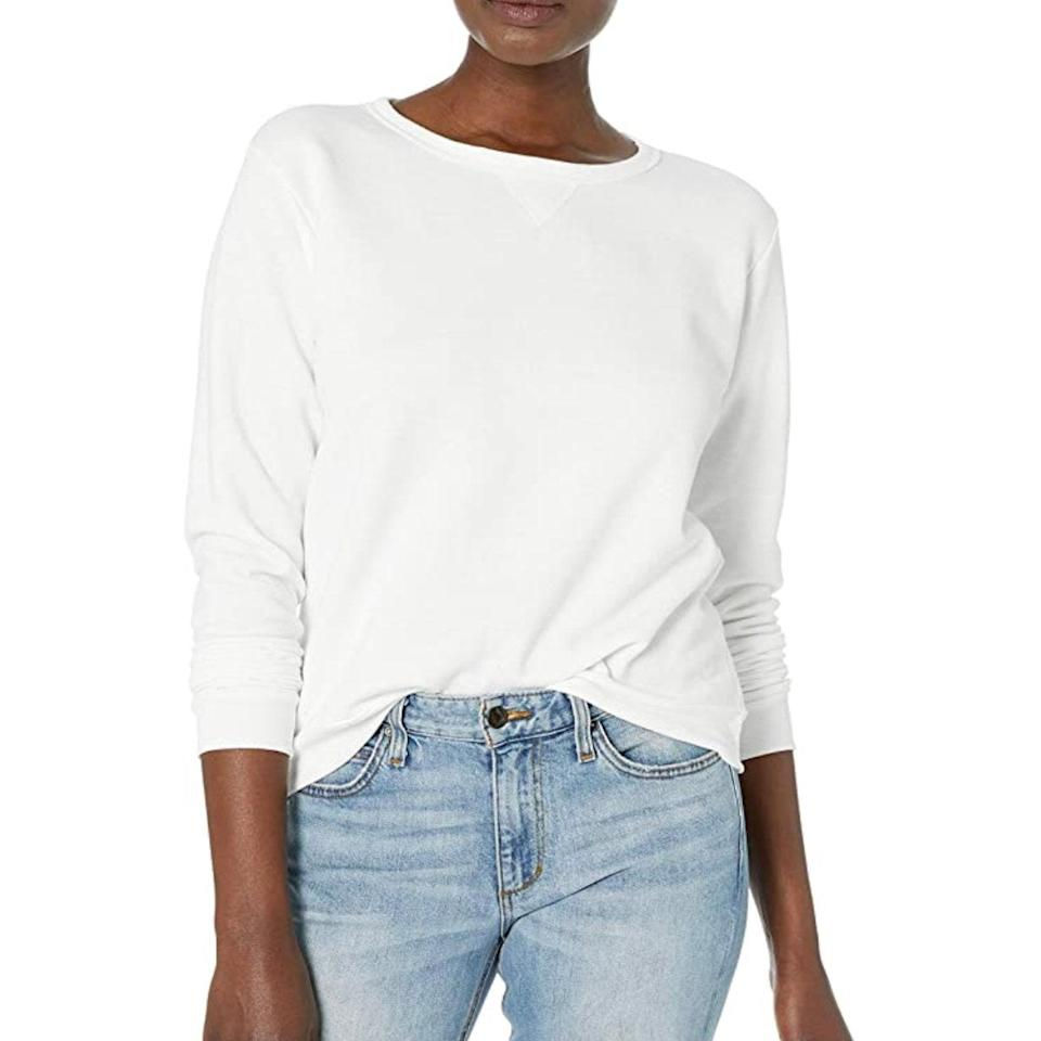 """Over its 120 years of existence, Hanes has proven it knows how to do basics right. This white crewneck is a prime example. $9, Amazon. <a href=""""https://www.amazon.com/Hanes-Womens-V-Notch-Pullover-Sweatshirt/dp/B01I8JLKUI/ref=sr_1_9?"""" rel=""""nofollow noopener"""" target=""""_blank"""" data-ylk=""""slk:Get it now!"""" class=""""link rapid-noclick-resp"""">Get it now!</a>"""