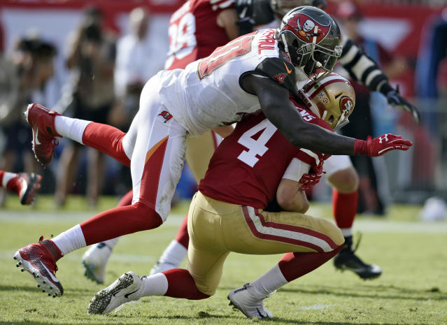 FILE - In this Sunday, Nov. 25, 2018, file photo, Tampa Bay Buccaneers defensive end Jason Pierre-Paul (90) sacks San Francisco 49ers quarterback Nick Mullens (4) during the first half of an NFL football game in Tampa, Fla. Pierre-Paul insists he doesnt have anything to prove in his first season with the Buccaneers. Hes been the best player on a largely disappointing defense, but says hes just doing his job. (AP Photo/Jason Behnken, File)