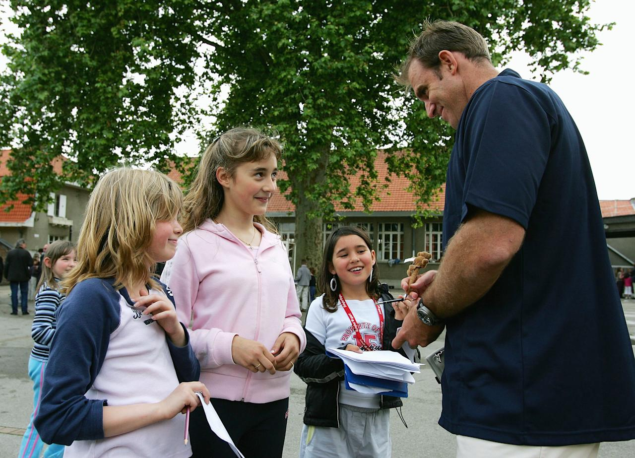 VILLERS-BRETONNEUX, FRANCE - JUNE 06: Matthew Hayden of Australia meets local school children during the Australian Cricket Team's visit to Victoria School, where the Australian World War I soldiers are remembered as heros on June 6, 2005 in Villers-Bretonneux, France. (Photo by Hamish Blair/Getty Images)
