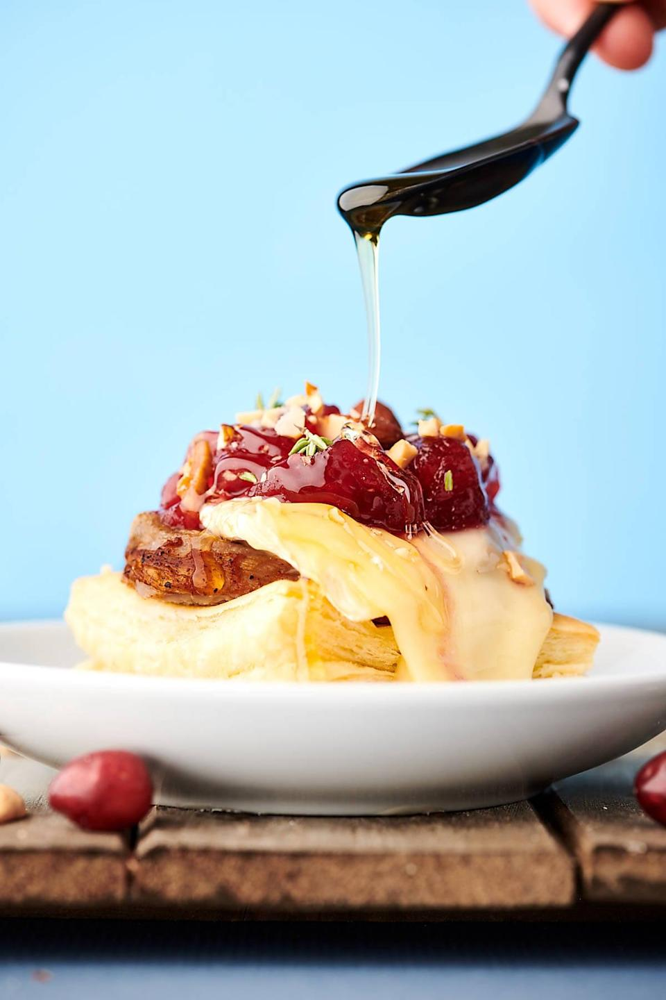 """<p>With only six ingredients needed, these puffy pastry bites will be the star of the show. Imagine sinking your teeth into a warm pastry that's topped with gooey brie, rich cranberry sauce, salty nuts, and flavorful pork tenderloin. Yum.</p> <p><strong>Get the recipe</strong>: <a href=""""https://showmetheyummy.com/pork-brie-puff-pastry-bites-recipe/"""" class=""""link rapid-noclick-resp"""" rel=""""nofollow noopener"""" target=""""_blank"""" data-ylk=""""slk:pork and brie puff pastry bites"""">pork and brie puff pastry bites</a></p>"""