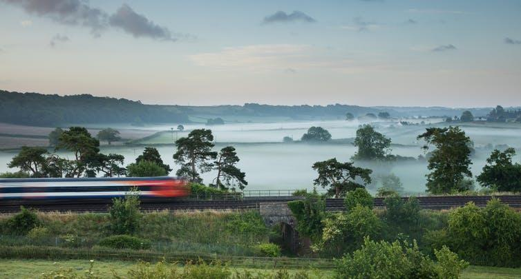 The London to Exeter service speeds through a misty Somerset landscape