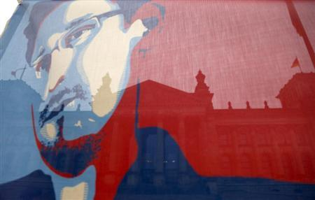 Reichstag pictured though flag depicting fugitive former U.S. NSA contractor Snowden in Berlin