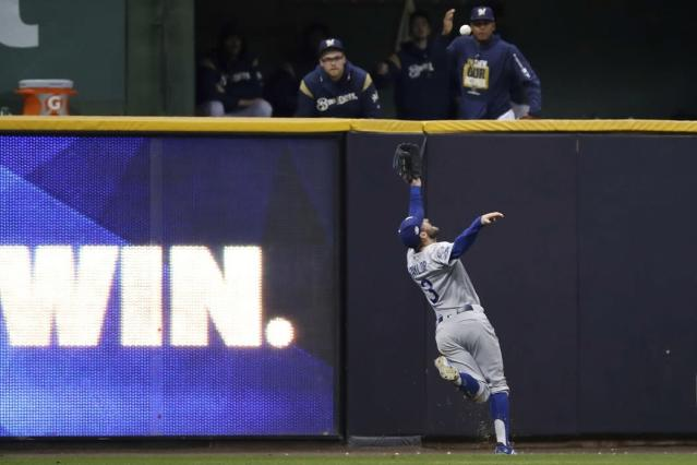 Los Angeles Dodgers left fielder Chris Taylor robs Milwaukee Brewers slugger Christian Yelich of a game-tying double in NLCS Game 7. (AP)