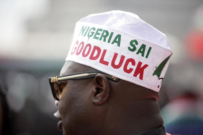 A supporter of the Nigerian president attends a ceremony in Abuja on November 11, 2014 (AFP Photo/Kolewole Oshiyemi)