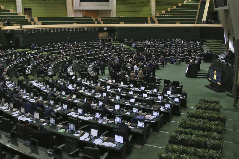 "This photo taken on Sunday, Feb. 19, 2017, shows an open session of the Iranian parliament in Tehran, Iran. Iran's parliament voted overwhelmingly Sunday to increase spending on its ballistic missile program and the foreign operations of its paramilitary Revolutionary Guard, chanting ""Death to America"" in a direct challenge to Washington's newest sanctions on the Islamic Republic. (AP Photo/Vahid Salemi)"
