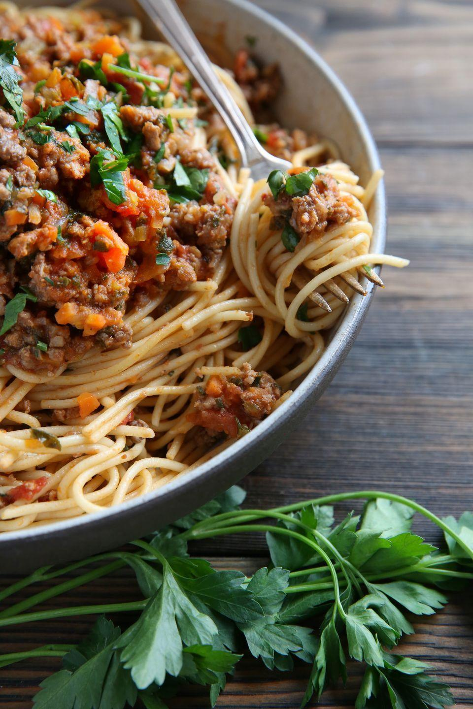 """<p>This ragu contains not one, but two different kinds of meat—pork sausage and ground beef— and *loads* of flavor.</p><p>Get the recipe from <a href=""""https://www.delish.com/cooking/recipe-ideas/recipes/a45800/sausage-kale-ragu-spaghetti-recipe/"""" rel=""""nofollow noopener"""" target=""""_blank"""" data-ylk=""""slk:Delish"""" class=""""link rapid-noclick-resp"""">Delish</a>.</p>"""