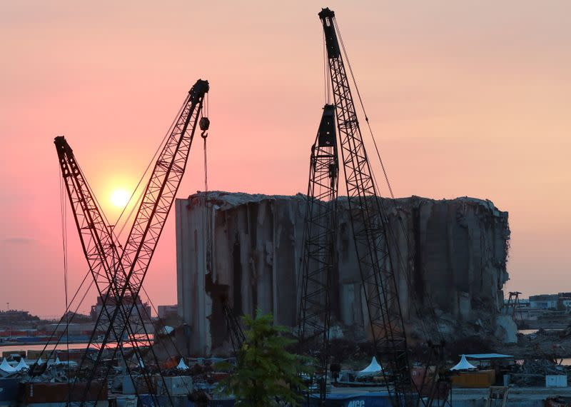 FILE PHOTO: A view shows the grain silo that was damaged during last year's Beirut port blast, during sunset in Beirut