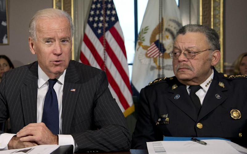 Vice President Joe Biden, with President of the Police Executive Research Forum and Major Cities Chiefs Association and Philadelphia Police Commissioner Charles Ramsey, speaks during a meeting at the Eisenhower Executive Office Building in the White House complex, Thursday, Dec. 20, 2012, in Washington. Biden is leading a task force that will look at ways of reducing gun violence. (AP Photo/Carolyn Kaster)
