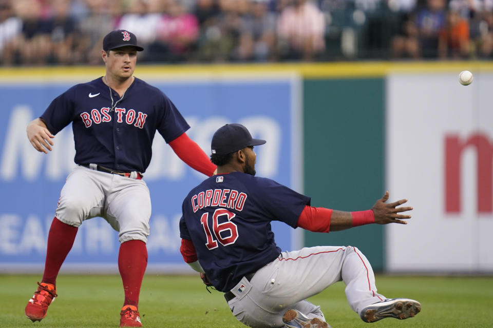 Boston Red Sox first baseman Franchy Cordero (16) and outfielder Hunter Renfroe can't get to a Detroit Tigers' Jonathan Schoop fly ball in the third inning of a baseball game in Detroit, Wednesday, Aug. 4, 2021. (AP Photo/Paul Sancya)