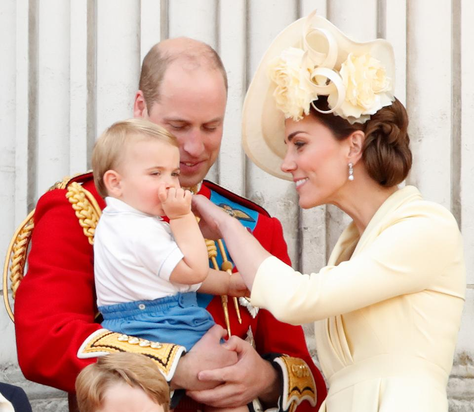 LONDON, UNITED KINGDOM - JUNE 08: (EMBARGOED FOR PUBLICATION IN UK NEWSPAPERS UNTIL 24 HOURS AFTER CREATE DATE AND TIME) Prince William, Duke of Cambridge, Catherine, Duchess of Cambridge and Prince Louis of Cambridge watch a flypast from the balcony of Buckingham Palace during Trooping The Colour, the Queen's annual birthday parade, on June 8, 2019 in London, England. The annual ceremony involving over 1400 guardsmen and cavalry, is believed to have first been performed during the reign of King Charles II. The parade marks the official birthday of the Sovereign, although the Queen's actual birthday is on April 21st. (Photo by Max Mumby/Indigo/Getty Images)
