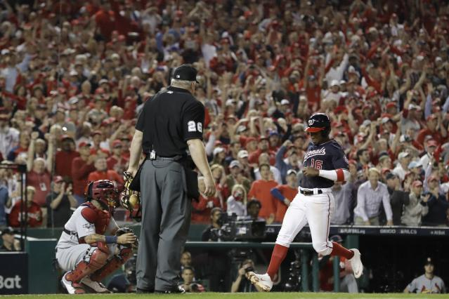 Washington Nationals' Victor Robles scores on a single by Adam Eaton during the third inning of Game 3 of the baseball National League Championship Series against the St. Louis Cardinals Monday, Oct. 14, 2019, in Washington. (AP Photo/Jeff Roberson)